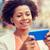 happy african businesswoman with smartphone stock photo © dolgachov