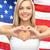 glimlachend · jonge · vrouw · shirt · tonen · hartvorm · liefde - stockfoto © dolgachov