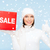woman in winter clothes with red sale sign stock photo © dolgachov