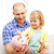 happy father and daughter with big piggy bank stock photo © dolgachov