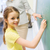 glimlachend · schoolmeisje · schrijven · klas · glimlach · wereldbol - stockfoto © dolgachov