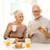 yaşlı · çift · kahvaltı · mutlu · mutfak · gülen - stok fotoğraf © dolgachov
