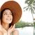 nő · szalmakalap · vízpart · mosolygó · nő · mosolyog · kamerába - stock fotó © dolgachov