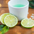 close up of body lotion in cup and limes on wood stock photo © dolgachov