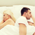 unhappy couple lying in bed at home stock photo © dolgachov
