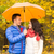 smiling couple with umbrella in autumn park stock photo © dolgachov