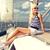 uśmiechnięty · młoda · kobieta · posiedzenia · jacht · pokład · wakacje - zdjęcia stock © dolgachov