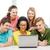 smiling students looking at laptop at school stock photo © dolgachov