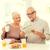 feliz · casal · de · idosos · café · da · manhã · casa · família · tecnologia - foto stock © dolgachov