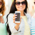 close up of happy young women with smartphone stock photo © dolgachov
