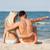 człowiek · wskazując · coś · posiedzenia · sympatia · plaży - zdjęcia stock © dolgachov