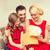 happy family opening gift box stock photo © dolgachov