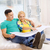 smiling couple looking at bluepring in new home stock photo © dolgachov