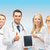 team or group of doctors with tablet pc computer stock photo © dolgachov