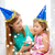 mother and daughter in party hats with cake stock photo © dolgachov