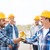 group of smiling builders shaking hands outdoors stock photo © dolgachov