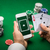 casino player with cards smartphone and chips stock photo © dolgachov