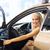 heureux · femme · souriante · séance · à · l'intérieur · nouvelle · voiture - photo stock © dolgachov