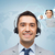 smiling businessman in headset stock photo © dolgachov