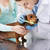 woman with dog and doctor at vet clinic stock photo © dolgachov