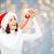 happy woman in santa hat with christmas ball stock photo © dolgachov
