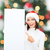 woman in santa helper hat with blank white board stock photo © dolgachov