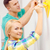 smiling couple painting small heart on wall stock photo © dolgachov
