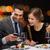 mosolyog · pár · eszik · főétel · étterem · ünnep - stock fotó © dolgachov