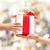 close up of child and mother hands with gift box stock photo © dolgachov