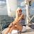 笑みを浮かべて · 若い女性 · 座って · ヨット · デッキ · 休暇 - ストックフォト © dolgachov