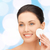 smiling woman cleaning face skin with cotton pad stock photo © dolgachov