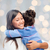 happy mother and daughter hugging stock photo © dolgachov