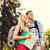 smiling couple with map and backpack in nature stock photo © dolgachov