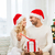 happy couple at home with christmas gift box stock photo © dolgachov