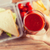 close up of woman hand holding tomato juice glass stock photo © dolgachov