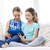 happy girls with tablet pc sitting on sofa at home stock photo © dolgachov