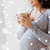 close up of pregnant woman with tea cup at window stock photo © dolgachov