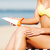 girl putting sun protection cream on beach chair stock photo © dolgachov