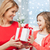 smiling mother and daughter with gift box at home stock photo © dolgachov