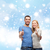 happy couple showing thumbs up and hugging stock photo © dolgachov