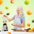 smiling woman with blender preparing shake stock photo © dolgachov