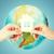 couple hands holding green house over earth globe stock photo © dolgachov