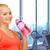 gelukkig · vrouw · drinkwater · fles · gymnasium · mensen - stockfoto © dolgachov