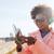 счастливым · африканских · женщину · смартфон · наушники · люди - Сток-фото © dolgachov