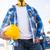 close up of builder holding hardhat at building stock photo © dolgachov