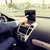 close up of young man with tablet pc driving car foto stock © dolgachov