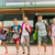 group of happy elementary school students running stock photo © dolgachov