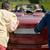 happy friends pushing broken cabriolet car stock photo © dolgachov