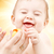 laughing baby boy in mother hands with rubber duck stock photo © dolgachov