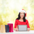 smiling woman in santa helper hat with tablet pc stock photo © dolgachov